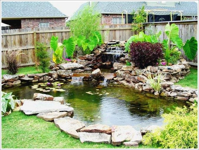 Backyard with small pond pictures 02 for Outdoor fish ponds designs