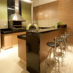 Modern kitchen items blend in brushed steel and wood