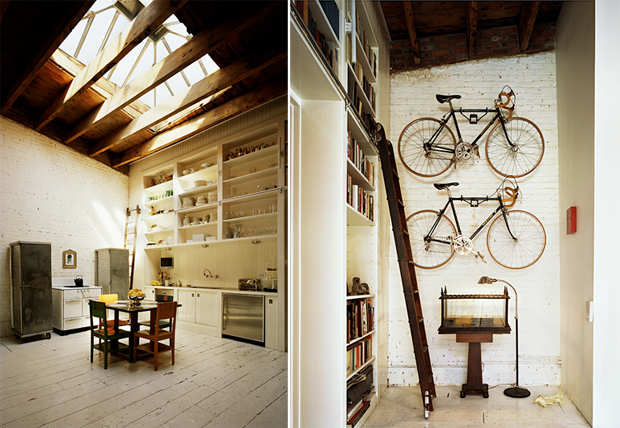 A large skylight lights the kitchen of the house, on the fourth floor from the building. The 2 bicycles hanging next to the library refer to the past cyclist from the homeowner.